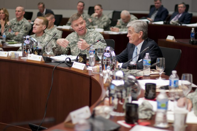 "Secretary of the Army John McHugh listens as Commander of the Combined Arms Center Lt. Gen. David G. Perkins briefs during a visit at the U.S. Army Training and Doctrine Command, to discuss how the future force will train to fight and win our nation's wars, April 20, 2012 at Joint Base Langley""Eustis, Va. TRADOC develops, educates and trains Soldiers, civilians, and leaders; supports unit training; and designs, builds and integrates a versatile mix of capabilities, formations, and equipment to strengthen the U.S. Army as America's Force of Decisive Action.(U.S. Army Photo by Staff Sgt. Bernardo Fuller)"