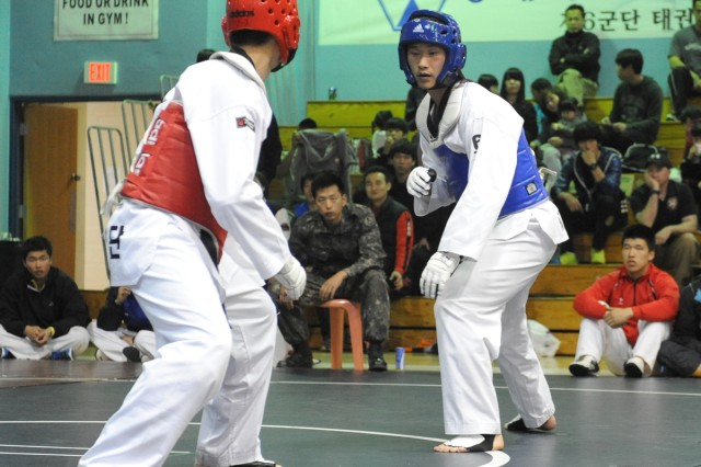 The Combined Forces Command hosted a Combat Tae Kwon Do competition at the Seoul American High School Falcon Gym on Yongsan Garrison, South Korea, April 21, 2012.