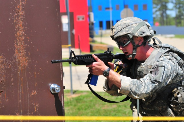 First Lt. Joshua Gorcyzniski of 1st Battalion, 28th Infantry Regiment, 4th Infantry Brigade Combat Team, 1st Infantry Division, prepares to enter a building during the Best Ranger Competition, April 13, 2012, at Fort Benning, Ga.