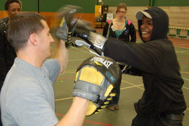 MILWAUKEE -- Jonathan James, a 10th grade student at Case High School, tests his punching accuracy with Capt. Michael Benedosso, a boxer with the World Class Athlete Program, during a Pathway to Success event in Racine, Wis., April 19.