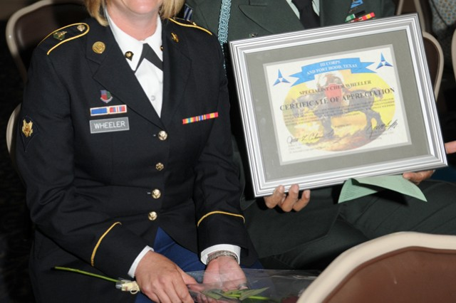 Spc. Cher Wheeler, from 3rd Cavalry Regiment, received the Better Opportunities for Single Soldiers Volunteer of the Year award Apr. 20 at Club Hood. The award represented her contributions in a variety of services within the community. (U.S. Army photo by Sgt. Lance Pounds)