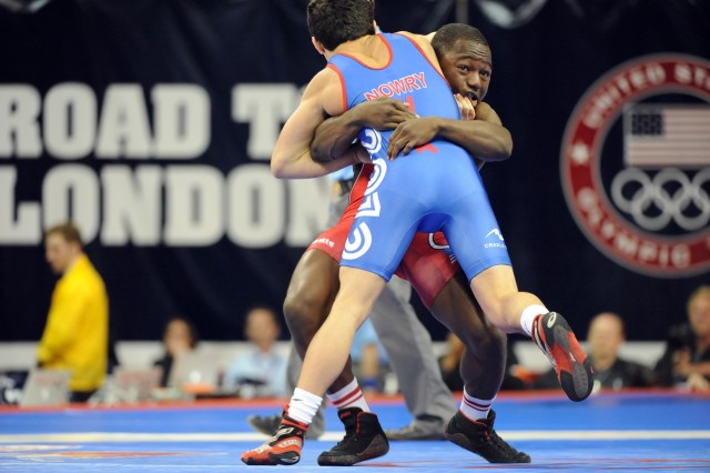 Sgt. Spenser Mango earns his second Olympic berth with a 1-0, 3-0 victory over Max Nowry of the New York Athletic Club in the 55-kilogram/121-pound Greco-Roman division of the 2012 U.S. Olympic Trials for Wrestling on April 21, 2012, at Carver-Hawkeye Arena in Iowa City, Iowa.