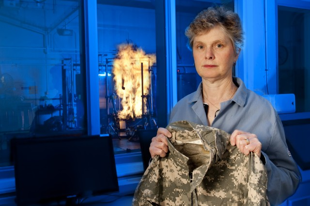 Peggy Auerbach, a textile technologist with the Ouellette Thermal Test Facility at the Natick Soldier Research, Development and Engineering Center in Massachusetts, tests the flame resistance of uniform and equipment materials.