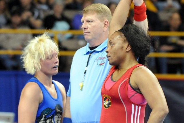 U.S. Army World Class Athlete Program Sgt. Iris Smith of Fort Carson, Colo., gets her hand raised after defeating Gator Wrestling Club's Kristie Davis of Yukon, Okla., for true third place in the women's 72-kilogram/158.5-pound division of the 2012 U.S. Olympic Wrestling Trials at Carver-Hawkeye Arena in Iowa City, Iowa.