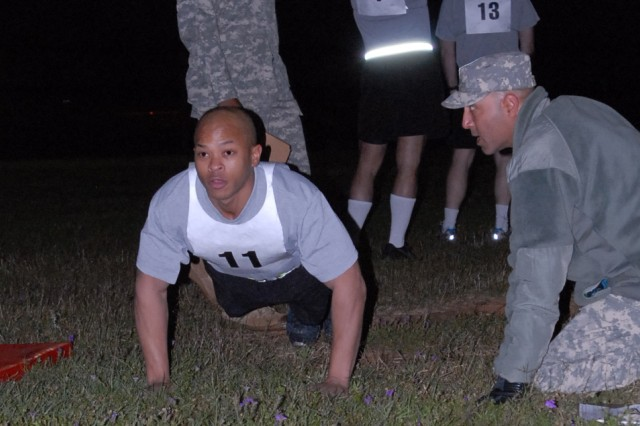 Pfc. Suni Muhammad, 401st Chemical Company, during the push-up event of the  Army Physical Fitness Test during the 412th Theater Engineer Command's 2012 Best Warrior Competition at Fort Rucker Ala., April 24, 2012. The best noncommissioned officer and junior enlisted Soldier from this competition will hold the title of Best Warrior for one year throughout the command and will compete in the United States Army Reserve Command's Best Warrior competition in June at Fort McCoy, Wis.  Winners of the USARC competition will compete at the Army level.