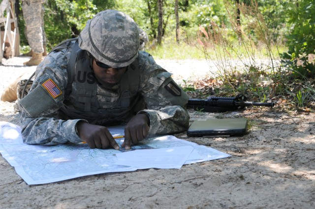 Sgt. Frank Namukangula, 382nd Military Police Battalion, plots his points before starting the land navigation event at the 412th Theater Engineer Command's 2012 Best Warrior Competition at Fort Rucker, Ala. April 24, 2012. The best noncommissioned officer and junior enlisted Soldier from this competition will hold the title of Best Warrior for one year throughout the command and will compete in the United States Army Reserve Command's Best Warrior competition in June at Fort McCoy, Wis. Winners of the USARC competition will compete at the Army level.