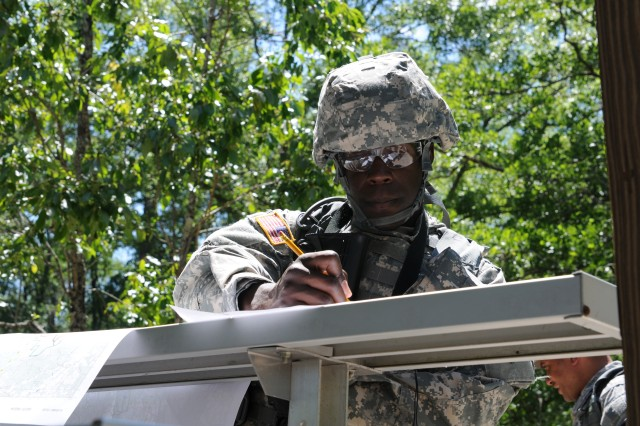 Spc. Zedrik Pitts, 465th Engineer Company, plots his points before competing in the land navigation event during the 412th Theater Engineer Command's 2012 Best Warrior Competition at Fort Rucker, Ala. April 24, 2012. The best noncommissioned officer and junior enlisted Soldier from this competition will hold the title of Best Warrior for one year throughout the command and will compete in the United States Army Reserve Command's Best Warrior competition in June at Fort McCoy, Wis. Winners of the USARC competition will compete at the Army level.
