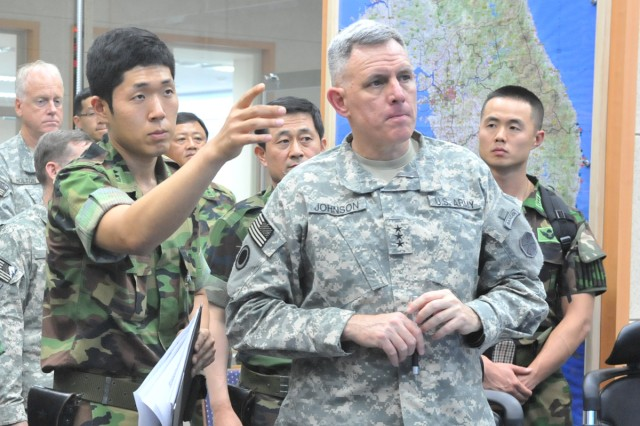 Eighth Army Commanding General Lt. Gen. John D. Johnson (right) attends a briefing with the ROK Army.