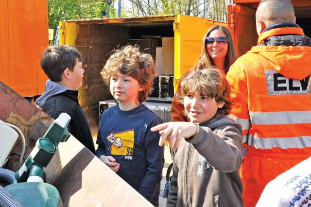 Aukamm Elementary School students Oskar Hurst (right) and Dawson Battles examine separated materials at the Wiesbaden, Germany, landfill during a tour for Earth Day, April 17, 2012.