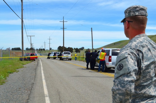 Army Capt. Bryan Anderson, 596th Transportation Brigade Provost Marshal, observes members of the 834th Transportation Battalion's Deptpartment of the Army Civilian Police force during the 2012 Coyote Shield exercise at Military ocean terminal Concord, Calif., April 16-19.