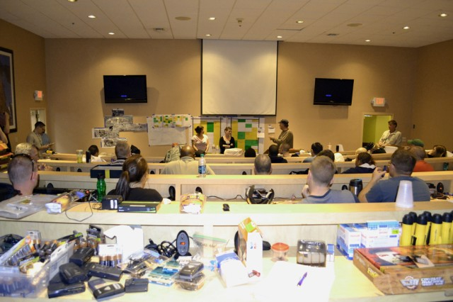 Exercise participants and facilitators take part in an end-of-the-day recap/briefing during the 2012 Coyote Shield anti-terrorism/force protection exercise held at Military Ocean Terminal Concord, Calif., April 16-19.