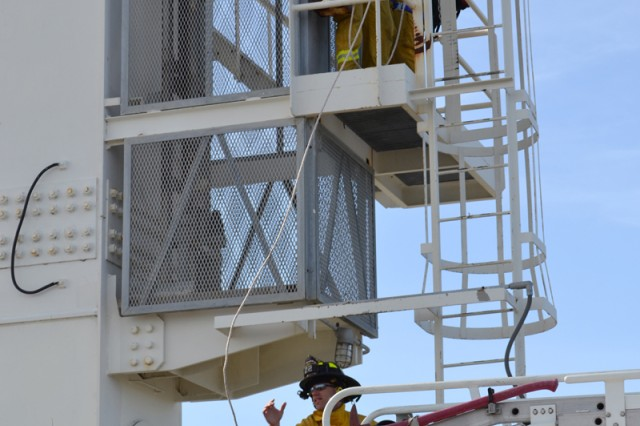 Personnel from Military Ocean Terminal Concord, Calif., and the Contra Costa County fire department execute a mock high crane rescue during the 2012 Coyote Shield anti-terrorism/force protection exercise held at MOTCO April 16-19.