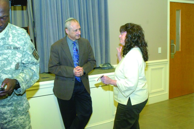 Rabbi Ben Romer of Richmond's Congregation Or-Ami chats with Amy Blumenthal, a contractor at CASCOM, after speaking April 18 at Fort Lee's Holocaust Remembrance Day Observance at Liberty Chapel.