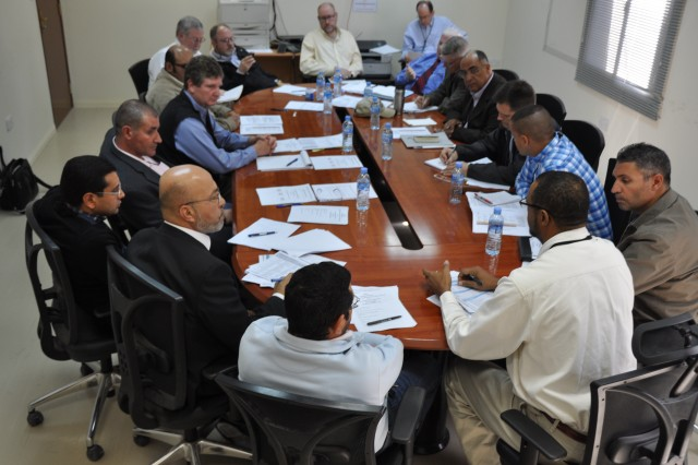 The Middle East District conducts partnering sessions with contractors to improve teamwork on construction sites. A session in Qatar focused on completion of a parking apron.