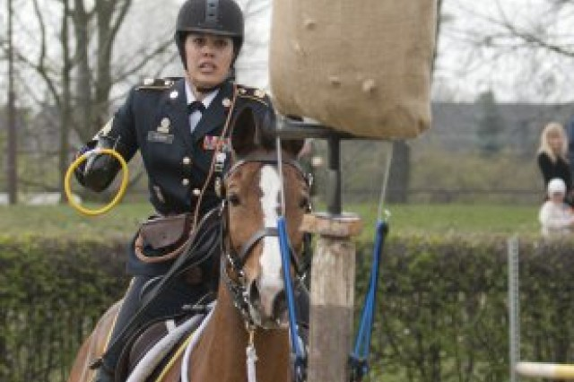 Master Sgt. Cindy Babb, from the Army Reserve's 200th Military Police Command, uses her saber during the skills at arms portion of the 2012 World Cavalry Championships in Poznan, Poland, April 20, 2012.