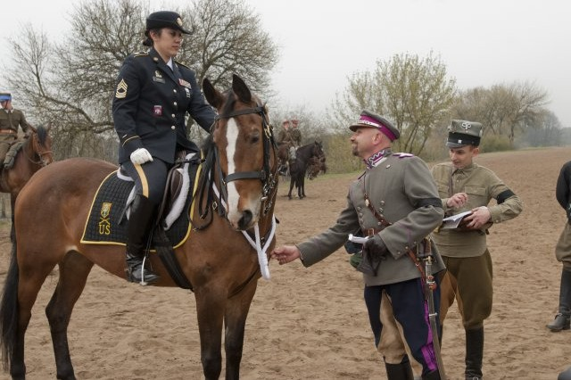 Master Sgt. Cindy Babb, from the Army Reserve's 200th Military Police Command, holds her horse steady during an inspection at the 2012 World Cavalry Championships in Poznan, Poland, April 20, 2012.