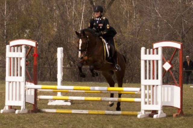 Master Sgt. Cindy Babb, from the Army Reserve's 200th Military Police Command, works through one of nine gates in the show jumping event of the 2012 World Cavalry Championships in Poznan, Poland, April 19, 2012.