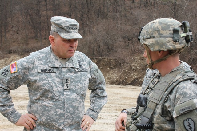 "Gen. James P. Thurman, commander of the United Nations Command, Combined Forces Command, and U.S. Forces Korea, visits with an officer from 1-21 Infantry Regiment. Thurman visited many training sites conducted by the ""Gimlets"" during exercise Foal Eagle, April 1-30, 2012."
