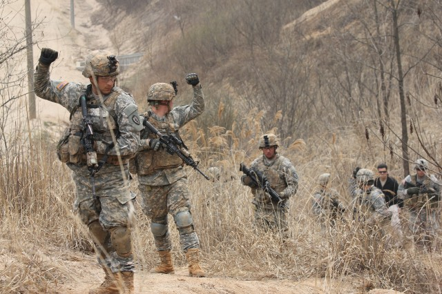 A squad from 2nd platoon, Bravo Company, 1-21 Infantry Regiment, executes a halt while on a counter improvised explosive device exercise lane. The Soldiers were practicing their observation and reporting skills during Exercise Foal Eagle on the Korean Peninsula, April 1-30, 2012.