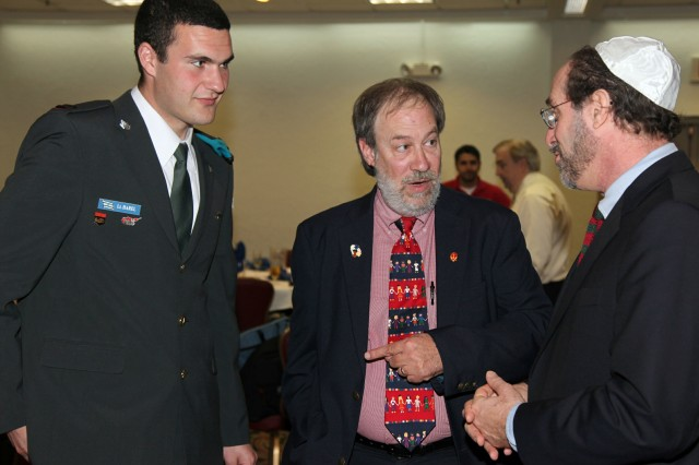 Writer Michael Korenblit (center) chats with 1st Lt. Eyal Harel, Israeli Defense Force, and Michael Jacobs, Fort Sill Jewish Distinctive Faith Group leader, after Fort Sill's National Days of Remembrance ceremony April 19 at the Patriot Club.