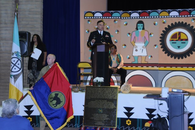 Maj. Gen. Beck addresses the audience during the inaugral Hopi Code Talker Recognition Day on April 23 where Beck was the guest speaker. Eight code talkers were assigned to the Wildcat Division during WWII and Chief Warrant Officer 3 Jeffrey Osler is wearing a WWII uniform and displays the 81st colors. The bronze plaque in the center also has the Wildcat symbol and is dedicated to the code talkers, the last of whom passed away in 2010. Two other code talkers were assinged to the 5th Army Air Forces