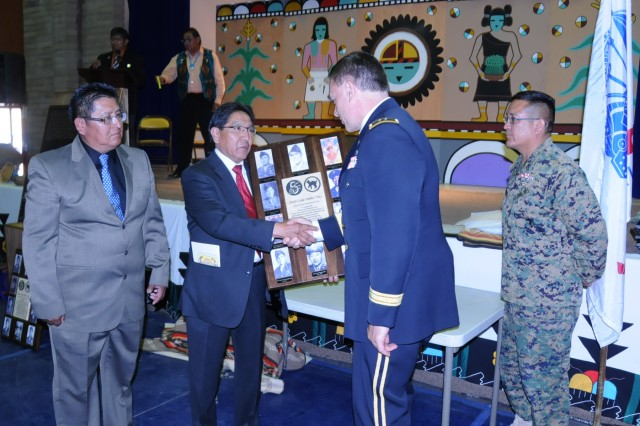 Maj. Gen. Beck receives a plaque from Vice Chairman of the Hopi tribe Herman Honanie during the inaugral Hopi Code Talker Recognition Day on April 23 where Beck was the guest speaker. Eight code talkers were assigned to the Wildcat Division during WWII.
