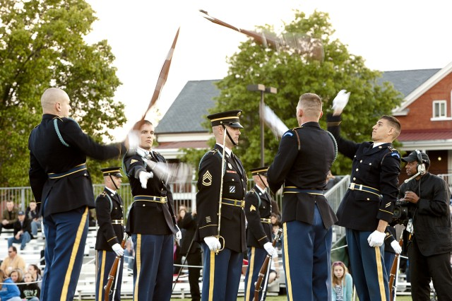 The U.S. Army Drill Team, 3d U.S. Infantry Regiment (The Old Guard) performs during the Twilight Tattoo on Summerall Field on Joint Base Myer-Henderson Hall.