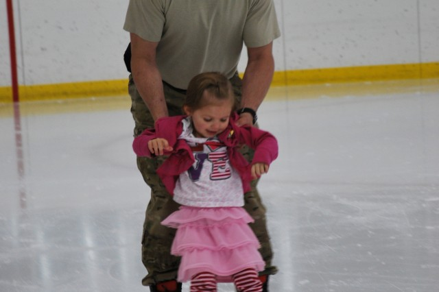 Brennan, daughter of Christina and Sgt. Joseph Seeley, 2nd Battalion, 8th Field Artillery Regiment, 1st Stryker Brigade Combat Team, 25th Infantry Division took a spin around the ice with her dad on Saturday at the Fort Wainwright ice rink. Seeley recently returned from deployment to Afghanistan. (Photo by Trish Muntean/Fort Wainwright PAO)