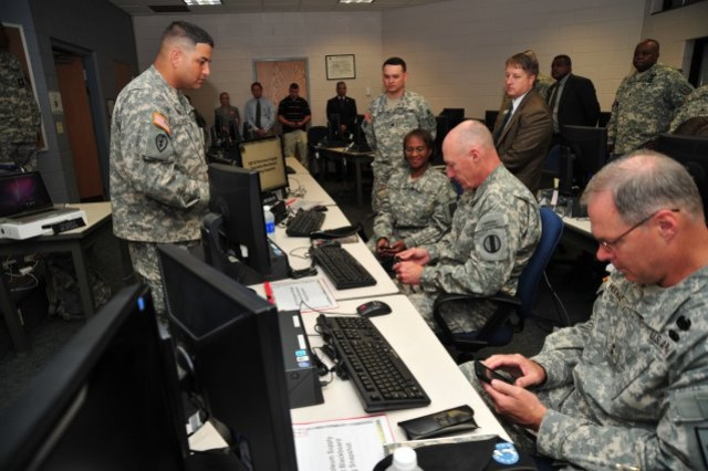 Staff Sgt. Richard Melendez, Unit Supply Specialist instructor, in the Quartermaster School's Logistics Training Department, explains the iPhone pilot training program to Gen. Robert W. Cone, Training and Doctrine Command commanding general, Maj. Gen. James L. Hodge, Combined Arms Support Command commanding general, and Brig. Gen. Gwen Bingham, Quartermaster General. The pilot is an initiative generated from TRADOC's Connecting Soldiers to Digital Applications program.