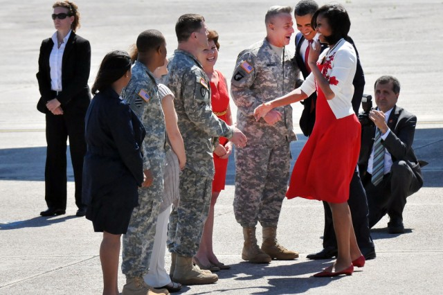 President and Mrs. Obama greet the Hunter Army Airfield leadership, including Col. Christopher Hughes, 3rd Infatry Division deputy commanding general-support, Marguerite Hughes, Lt. Col. Ed Kovaleski, Hunter garrison commander, Marcie Kovaleski, Hunter Command Sgt. Maj. Stanley Hood and Mrs. Hood, when they exited Air Force One, April 27, 2012. The Obamas were enroute to Fort Stewart, Ga., where they announced and signed an executive order preventing scams used to con veterans out of their federal education benefits.
