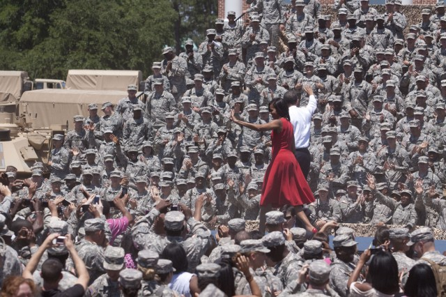 President Barack Obama and First Lady Michelle Obama wave to the Fort Stewart, Ga., crowd, April 27, 2012. The Obamas visited the Georgia Army Installation to announce and sign an executive order preventing scams used to con veterans out of their federal education benefits.