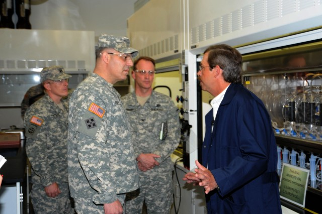 Brig. Gen. (Promotable) Gustave F. Perna tours the smoke pot container line at the Pine Bluff Arsenal, Ark., April 18.