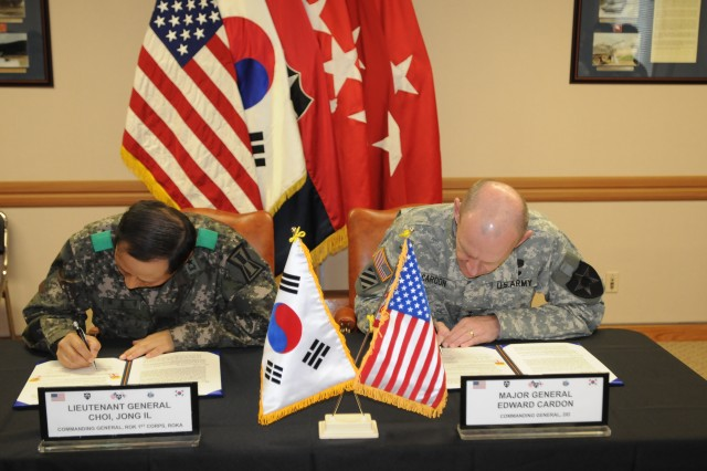 Lt. Gen. Choi Jong Il, commander of the Republic of Korea's I Corps, and Maj. Gen. Edward Cardon, commander of the 2nd Infantry Division, signed a memorandum of understanding April 27, 2012, to conduct more joint maneuvers exercises and share intelligence. Signed on Camp Red Cloud, South Korea, this accord will help strengthen interoperability between the U.S.-ROK alliance.