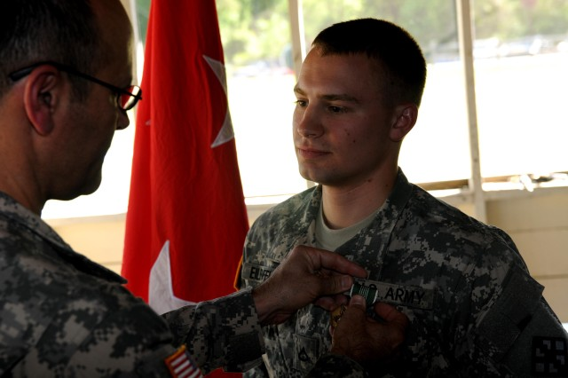 Pfc. Nathan Eilenfeldt, 463rd Engineer Battalion, the 412th Theater Engineer Command 2012 Best Warrior Competition winner, in the lower enlisted Soldier category, receives the Army Commendation Medal from Maj. Gen. William M. Buckler Jr., commander 412th TEC, at Fort Rucker, Ala. April 28, 2012.