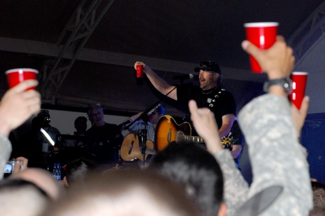 Playing to the base: Toby Keith sings at Camp Buehring during his 'Live In Overdrive' USO tour