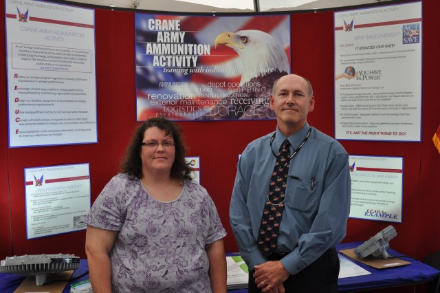Crane Army Ammunition Activity employee Angela Bray received a Building Energy Monitor Award April 26 from CAAA Civilian Executive Assistant Norman Thomas at the Crane Energy Expo for her as an energy monitor that significantly contributed to the efficiency of the ammunition activity.