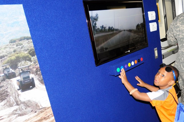 FORT SAM HOUSTON, Texas - Julian McKelvin, 5, checks out the video displays inside the Command Information Mobile Exhibition Trailer, part of the U.S. Army North display at the Fort Sam Houston Fiesta and Fireworks April 22. The annual event is part of San Antonio's Fiesta, an 11-day event celebrating the city's history and heroes. Representatives from Army North met with members of the local community and spoke with them about the unit and its unique mission. (U.S. Army photo by Sgt. 1st Class Christopher DeHart, Army North PAO)