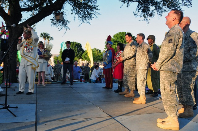 FORT SAM HOUSTON, Texas - Lt. Gen. William Caldwell IV (right), commanding general, U.S. Army North and senior commander, Fort Sam Houston and Camp Bullis, laughs as Richard Ojeda, El Rey Feo LXIV, jokingly complains about the cascarones, or confetti eggs, staining his bald head April 22, during the Commander's Reception in the Quadrangle as part of the 2012 Fort Sam Houston Fiesta and Fireworks. (U.S. Army photo by Sgt. 1st Class Christopher DeHart, Army North PAO)