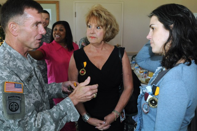 FORT SAM HOUSTON, Texas - Lt. Gen. William Caldwell, commanding general, U.S. Army North, and senior commander, Fort Sam Houston and Camp Bullis, shares his commitment to the Adopt-a-School program with Cindi Jacob, principal, Wilshire Elementary School, and Christina Reck, principal, East Terrell Hills Elementary, during an Adopt-a-School luncheon April 18 at the Fort Sam Houston Golf Club. Caldwell also presented 2012 Fort Sam Houston Fiesta medals to the principals. Units from Fort Sam Houston have partnered with nine nearby schools to provide mentors and tutors for area school children and to participate in activities with the schools. (U.S. Army photo by Staff Sgt. Keith Anderson, Army North PAO)