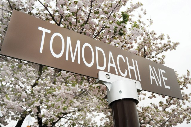 The newly unveiled signpost for Tomodachi Avenue is displayed following a ceremony at Camp Zama, Japan.