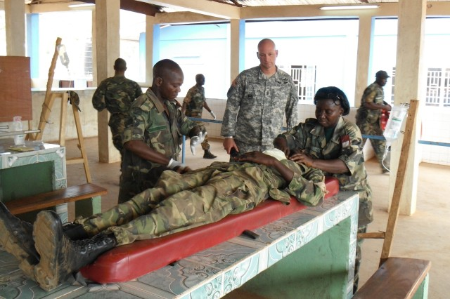 Sgt. Maj. Gavin McIlvenna, U.S. Army Africa (USARAF) military mentor, works with members of the Republic of Sierra Leone Armed Forces (RSLAF) on basic soldiering skills in preparation for the African Union Mission in Somalia (AMISON).