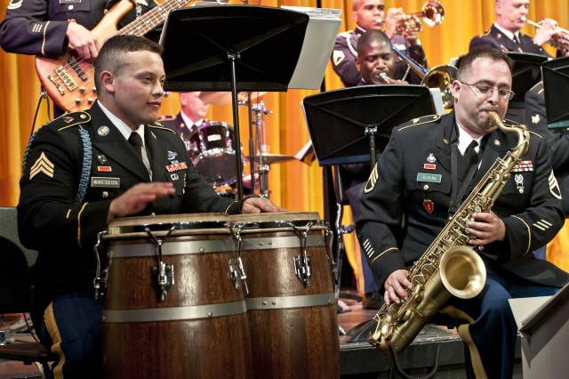Sergeant Norman Montes De Oca (left), a former Ranger who served two years in the 2nd Ranger Battalion at Joint Base Lewis-McChord, Wash., plays the congas during a performance with the 56th Army Band's swing ensemble, Swingin' Sounds of Courage, for members of the Eureka, Calif., community at Eureka High School April 27 during a visit to the northern California coastal town April 26-29 to play for the town and march in its annual Rhododendron Parade. Montes De Oca always dreamed of becoming a Ranger, but a chance occurrence in February 2010 inspired him to shift gears and try out for the 56th Army Band.