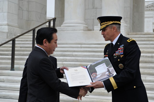 Japan's Prime Minister Yoshihiko Noda participated in an Armed Forces Full Honor Wreath Laying Ceremony at the Tomb of the Unknowns at Arlington National Cemetery honoring the sacrifice of America's veterans in foreign wars April 30, 2012.  Noda was escorted by U.S. Army Military District of Washington's (MDW) Commanding General, Maj. Gen. Michael S. Linnington.(U.S. Army Photo by Mr. Leroy Council, AMVID)