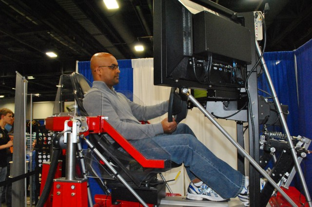 Gopa Nair, a father of two little girls and computer scientist from Centreville, Va. takes the Synthetic Automotive Virtual Environment or SAVE for a spin at the 2012 USA Science and Engineering Expo in Washington April 29. SAVE was developed by researchers at the U.S. Army Corps of Engineers' Cold Regions Research and Engineering Laboratory.
