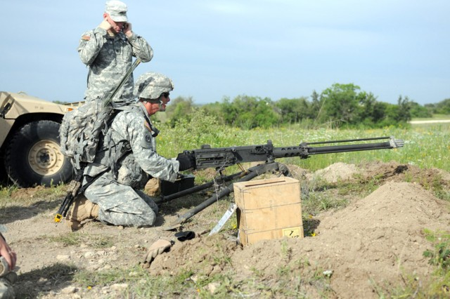 "FORT HOOD, Texas -- Sgt. Nathan Fredley, from 2nd Squadron ""Sabre"", 3rd Cavalry Regiment, returns fire using the M2 machine gun at a tactical control point lane during the unit's first Expert Infantryman Badge course Apr. 26. This task was designed to simulate a deployed environment. (U.S. Army photo by Sgt. Lance Pounds)"