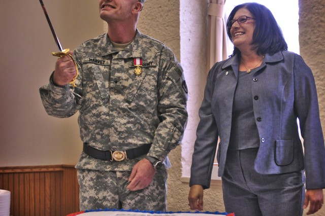 Brig. Gen. Thomas A. Harvey, deputy commanding general of Army Sustainment Command, holds the sword he and his wife, Debbie, used to cut the cake during Harvey's retirement and retreat ceremony at Rock Island Arsenal's Heritage Hall April 27. Harvey retired after 32 years of active federal military service.