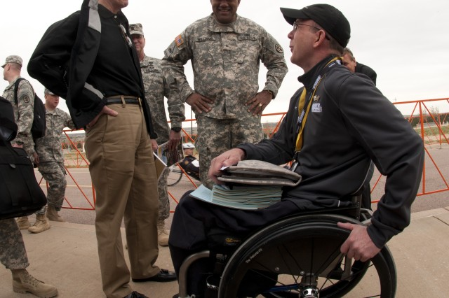 Secretary of the Army John McHugh along with Brig. Gen. Darryl A. Williams, commander of the Army's Warrior Transition Command meet with Soldiers and Army veterans participating in the third annual Warrior Games, May 1, 2012, in Colorado Springs, Colo..  Wounded, ill and injured service members and veterans from the Army, Marine Corps, Air Force, Navy, Coast Guard and Special Operations Command compete in track and field, shooting, swimming, cycling, archery, wheelchair basketball and sitting volleyball during the Warrior Games.  (U.S. Army photo by Staff Sgt. Bernardo Fuller)