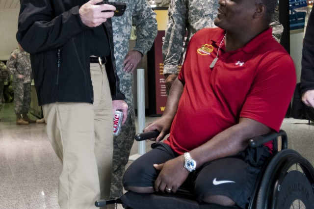 Secretary of the Army John McHugh watches a clip from the movie Battleship, in which Col. Gregory Gadson (to his left) plays as a double amputee during a visit to the Army's Warrior Games in Colorado Springs, Colo., May 1.  Gadson lost his legs in 2007 in Iraq where he served as a battalion commander.  Gadson is still on active duty and is set to take command of Ft. Belvoir in July 2012.  Wounded, ill and injured service members and veterans from the Army, Marine Corps, Air Force, Navy, Coast Guard and Special Operations Command compete in track and field, shooting, swimming, cycling, archery, wheelchair basketball and sitting volleyball during the 2012 Warrior Games.  (U.S. Army photo by Staff Sgt. Bernardo Fuller)