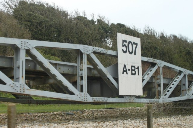 A portion of Mulberry Harbor's floating roadway, used by the Allies in World War II, is displayed at Omaha Beach in Normandy, France. The temporary harbor was developed and used to offload troops, vehicles and supplies on to the beaches during the Battle of Normandy in 1944.