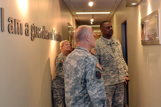 Gen. Lloyd J. Austin III, Vice Chief of Staff of the Army, and Gen. Ann E. Dunwoody, Commanding General of the U.S. Army Materiel Command, views the Villar tribute plaque with Col. Daniel T. Williams, Director of AMC Public Affairs, on a recent visit to headquarters AMC, here at Redstone Arsenal in Huntsville, Ala.; April 27. U.S. Army Photo by Chris Putman. AMC Public Affairs.